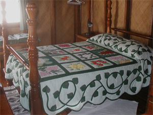 Flower Quilt on Four-Poster Bed